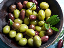 Wooden bowl full of olives. Royalty Free Stock Images