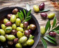 Wooden bowl full of olives. Stock Photos