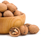 Wooden bowl full of walnuts Royalty Free Stock Image