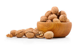Wooden bowl full of walnuts Royalty Free Stock Photos