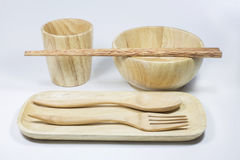 Wooden bowl and glass and spoon and fork and chopsticks and dish Royalty Free Stock Images