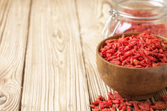 Wooden bowl with  goji berries Stock Image