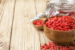 Wooden bowl with  goji berries Royalty Free Stock Photos