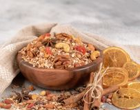 Wooden Bowl with granola with nuts, dried crandberries and dried stock image