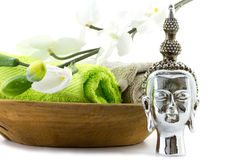 Wooden bowl with green towels and buddha Stock Photos