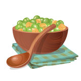Wooden bowl with green and yellow peas in it Royalty Free Stock Image