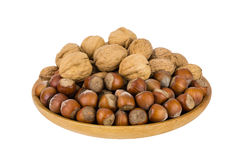Wooden bowl with hazelnuts and walnuts Royalty Free Stock Photos