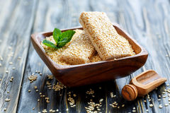 Wooden bowl with honey sesame bars. Stock Images