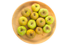 Wooden bowl of imperfect looking organic apples with unconventio. Wooden bowl full of imperfect looking organic apples with unconventionally raised method, no Royalty Free Stock Image