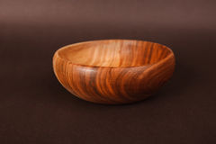 Wooden bowl isolated. On brown Royalty Free Stock Image