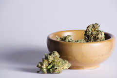 Wooden bowl with Marijuana Royalty Free Stock Image