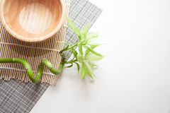 Wooden bowl on mat Stock Images