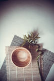 Wooden bowl on mat Royalty Free Stock Photos