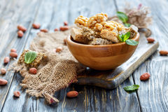 Wooden bowl with mint and honey bars with nuts and seeds. Stock Image