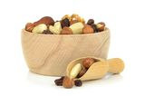 A wooden bowl of mixed fruit and nuts Stock Photos