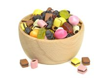 A wooden bowl of mixed sweets Royalty Free Stock Photo
