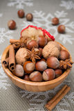 Wooden bowl with nuts and spices Royalty Free Stock Photography