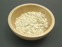 Wooden bowl with oat flakes Stock Photo
