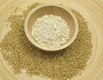 Wooden bowl with oat flakes and corn Stock Images