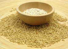 Wooden bowl with oat flakes and corn Stock Image