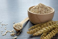 A Wooden Bowl of Oat Flakes Royalty Free Stock Photos