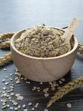 A Wooden Bowl of Oat Flakes Royalty Free Stock Photo