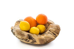 Wooden bowl with oranges and lemons Stock Photos