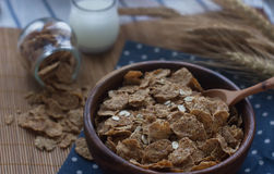 Wooden bowl of organic cornflakes and oatmeal. Nutritious breakfast, raw food ingredients Stock Images