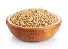 Wooden bowl with pearl barley isolated on white background. Royalty Free Stock Photography
