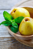 Wooden bowl with pears and mint. Stock Image
