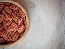 Pecan nuts on wooden table royalty free stock images