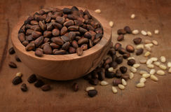 Wooden bowl of pine nuts Stock Photography