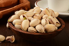 Wooden bowl of pistachios Royalty Free Stock Images