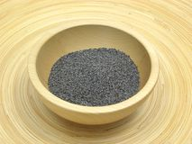 Wooden bowl with poppy seeds Royalty Free Stock Image