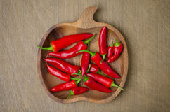 Wooden bowl with red chili peppers (space for text), top view Royalty Free Stock Photo