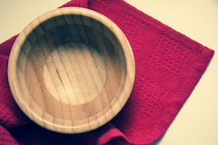 Wooden bowl on red towel Stock Photography