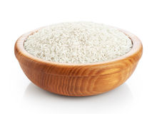 Wooden bowl with rice isolated on white background. Royalty Free Stock Photo
