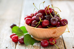 Wooden bowl with ripe cherries. Stock Image