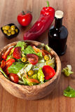 Wooden bowl with salad Stock Photos
