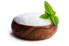 Wooden bowl with sea salt isolated on white. Wooden  bowl with sea salt isolated on white stock photography