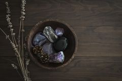 Wooden Bowl with Selection of Stones and Crystals royalty free stock image