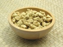 Wooden bowl with soy granules Stock Image