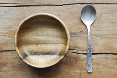 Wooden bowl and spoon Stock Photos