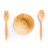 Wooden bowl, spoons and fork on white background Stock Photography
