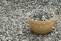 Wooden bowl with sunflower seeds Stock Photo