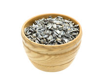 Wooden bowl with sunflower seeds Royalty Free Stock Photography