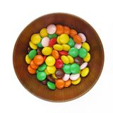 Wooden bowl with sweets Royalty Free Stock Photography