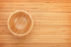 Wooden bowl on table Royalty Free Stock Photo