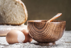 A wooden bowl and two eggs Royalty Free Stock Photos