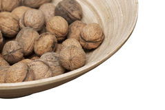 Wooden bowl with walnuts Royalty Free Stock Images